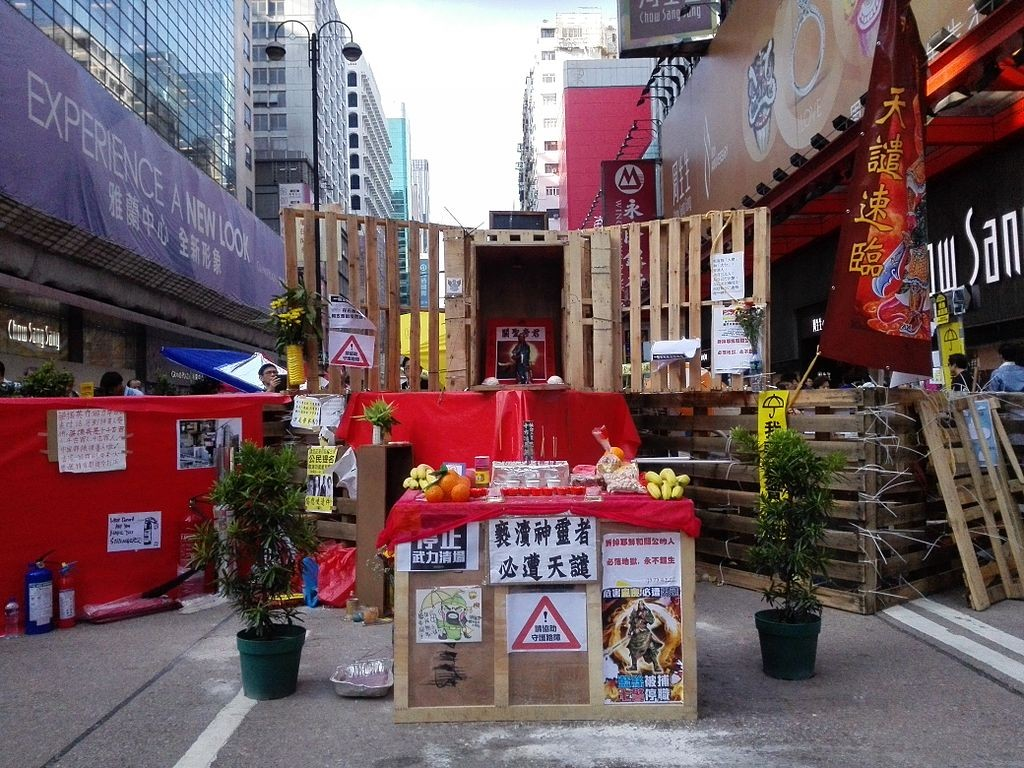 Temporary Guan Gong shrine at the Umbrella Movement barricade.