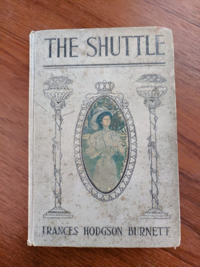 The gross, time worn cover of The Shuttle.