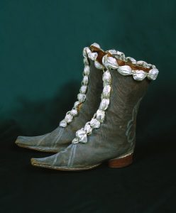 Nice brocade-faced men's boots with ribbon trim.