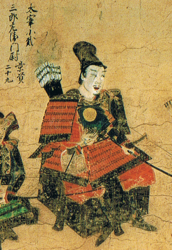 A warrior in red armor, on a camp stool with a fan.