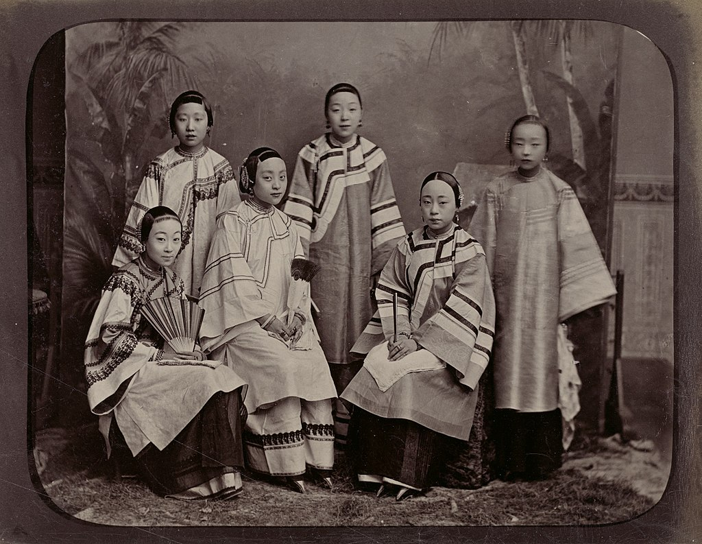 Six women sitting for a portrait. They're probably singing women.
