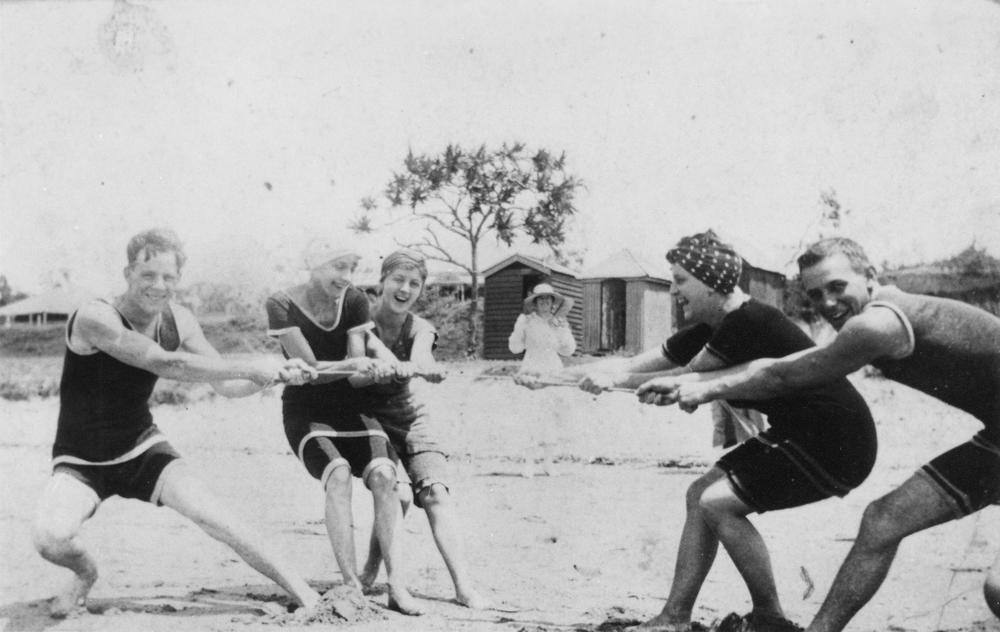 Tug of war in knit wool swimshorts and shirts.