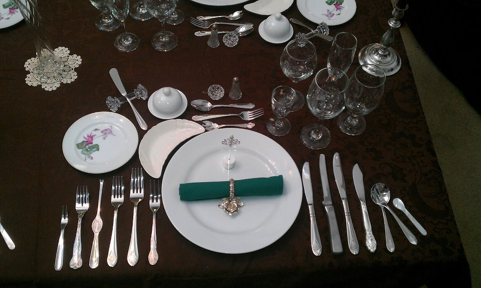 very formal place setting anticipating lots of seafood before the main course.