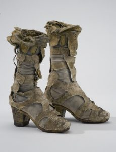 Boots of white calf leather, with gilt leather on top, and heels, made to look like Ancient Greek sandals, while actually being riding boots.
