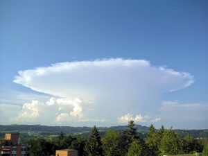 A big thunderstorm cloud with a characteristic flat anvil-like top.