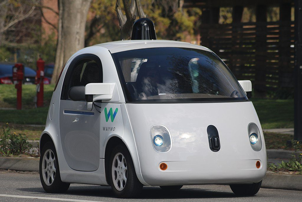 A 3/4 photograph of the google driverless car. Designed to be cute, actually, like a little face.