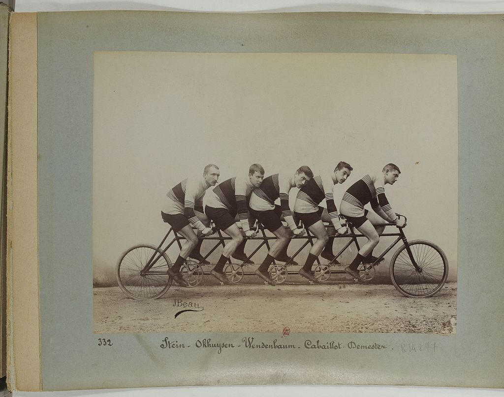 Five dapper gents on a five-bike.